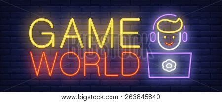 Game World Neon Text With Boy Playing Computer Game. Computer Games And Entertainment Advertisement