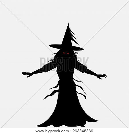 Halloween Black Silhouette Of A Scary Witch With Red Evil Eyes Over Withe Background