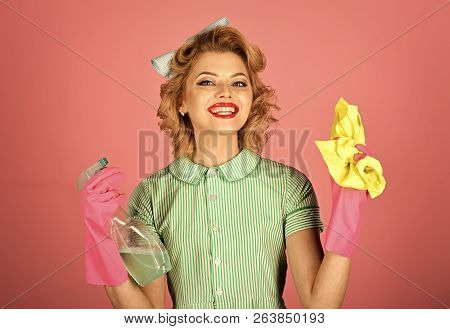 Retro woman cleaner on pink background. Housekeeper in uniform with clean spray, duster. Cleaning, retro style, purity. Cleanup, cleaning services, wife, gender. Pinup woman hold soup bottle, duster poster
