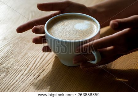 Relax In Cafe Or Coffee Shop And Drinking. Fresh Morning Coffee With Milk And Cream Froth. Barista P