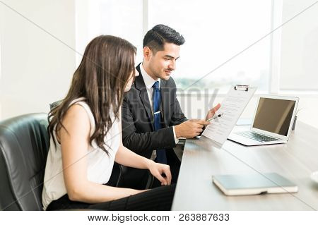 Young Lawyer And Attorney Reviewing Legal Document During A Meeting