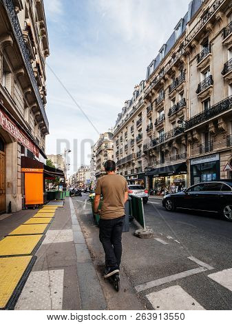 Paris, France - Oct 13, 2018: Man On Electric Scooter Commuting In Central Paris Vertical Photo