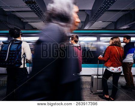 Paris, France - Oct 13, 2018: Elegant Woman Walking Near People Waiting In The Montparnasse Bienvenu