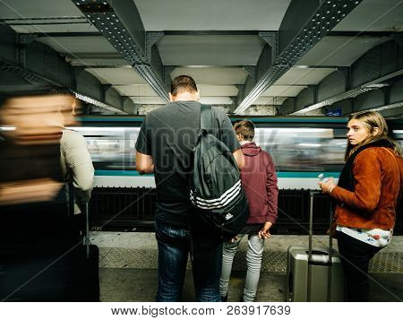 Paris, France - Oct 13, 2018: Rear View Of Commuters Large Crowd Of People Waiting In The Montparnas