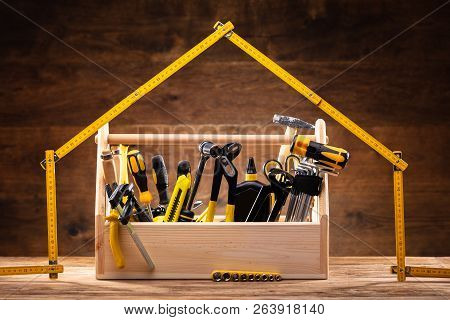 House Made Up Of Measuring Tape Over Toolbox With Various Worktools