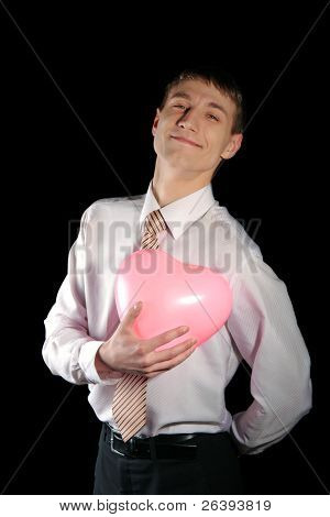 Man Holds A Pink Heart Balloon