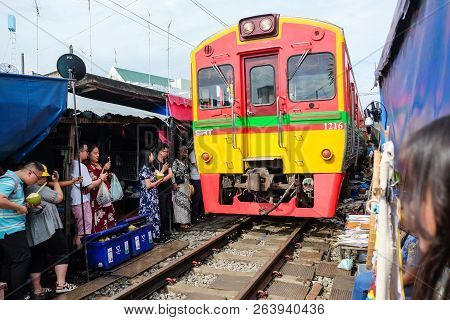 Samut Songkhram, Thailand - Oct 5, 2018 : The Famous Maeklong Railway Market (aka. Talad Rom Hub) At
