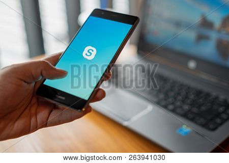 Chiang Mai, Thailand - July 14,2018: Man Holding Huawei With Skype Apps. Skype Is Part Of Microsoft,