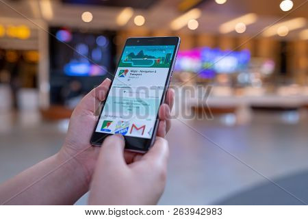 Chiang Mai, Thailand - August 03,2018: Woman Holding Huawei With Google Maps On The Screen.google Ma