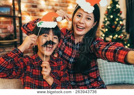 Woman And Daughter With Black Mustache Having Fun