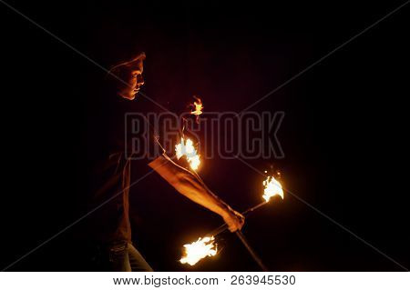 Fire Show. Fakir Dances With Two Staff. Night Performance. Fire And Smoke. Fascinating Flame Movemen