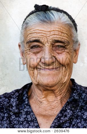 Image shows a happy old lady from a village in Greece poster