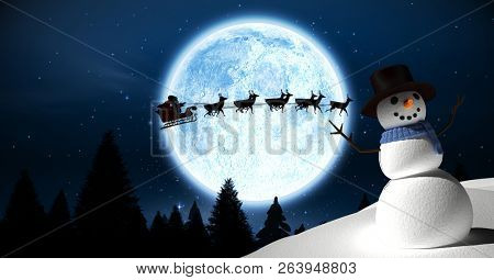 Digital composite of Snowman and Christmas moon with Santa in sleigh with reindeer
