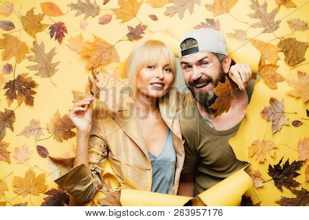 Fashion Portrait Of Beautiful Sensual Couple With Leaves On Autumn Leaves Background. Autumn Couple