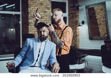 Hair Preparation is just for dashing chap. Bearded stylish barber shop client. Bearded client visiting barber shop. Barber scissors. Beard styling and cut. Making haircut look perfect in barber shop poster
