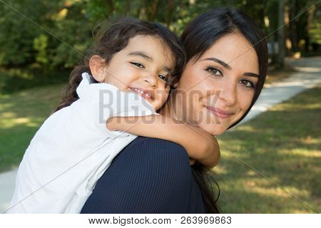 Family Parenthood Motherhood People Concepthappy Woman And Little Girl Having Fun In Summer Park