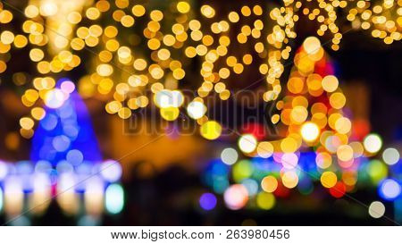 New Year In The Town Concept. Two Christmas Trees And Street Lights. Abstract Composite Blurry Backg
