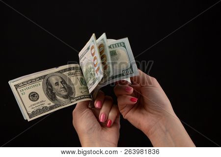 Hand Giving Money, United States Dollars Or Usd. Hands Holding Banknotes. Hands Holding A Dollar 100