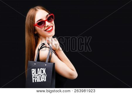 Elegant Rich Brunette Woman Wearing Black Dress And Sunglasses Smiling With Black Friday Shopping Ba
