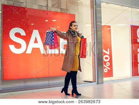 Young Woman In Shopping. Happy Woman With Shopping Bags Enjoying In Shopping. Consumerism, Shopping,