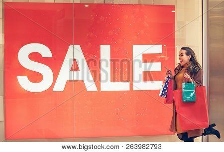 Big Sale- Woman In Shopping. Happy Woman With Shopping Bags Enjoying In Shopping. Consumerism, Shopp