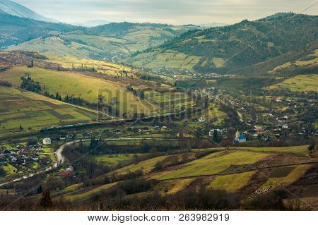 Village In The Valley. Bird Eye View. Rail Road And Viaduct In The Distance. Mysterious Autumn Weath