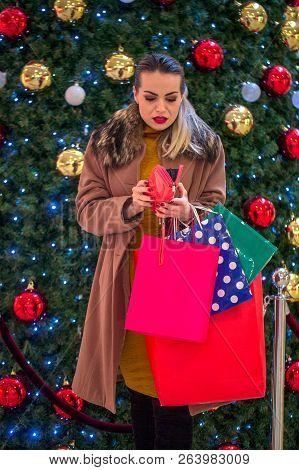 Woman In Shopping. Smiling Woman With Shopping Bags Enjoying In Shopping. Consumerism, Christmas, Sh