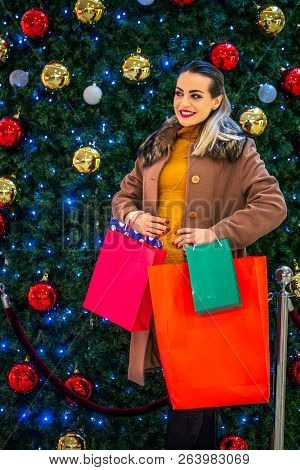 Consumerism, Christmas, Shopping, Lifestyle Concept Woman In Shopping. Smiling Woman With Shopping B