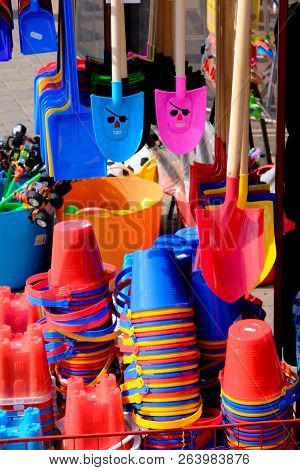 Multicoloured Seaside Toys And Buckets And Spades For Sale In A Shop