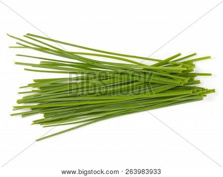 Some Uncut Chives On A White Background
