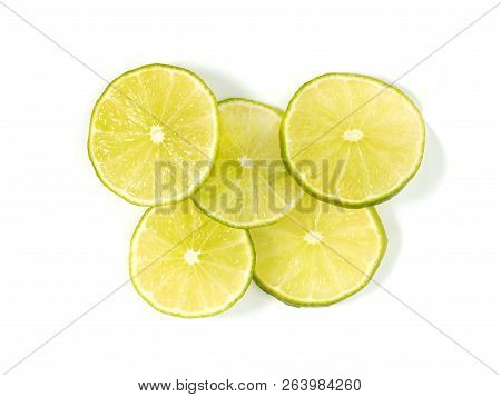 Some Sliced Lime On A White Background