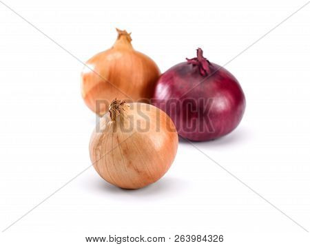 Three Round Onions On A White Background