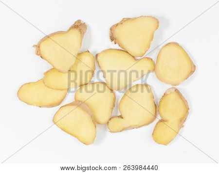 Sliced Ginger Root On A White Background