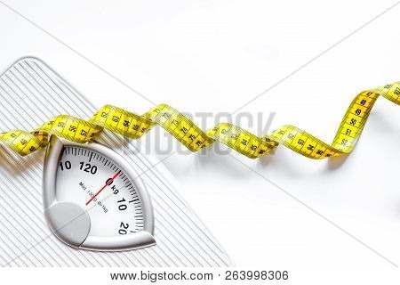 Floor Scale And Apple On White Background Top View