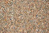 Pebbles inlaid in a durable paving or construction material. poster