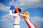 Girl use cunning trick in fight. Couple in love boxing gloves blue sky background. Girl close his eyes boxing gloves. Cunning strategy win. Savvy key to success. Blind boxer can not attack opponent poster