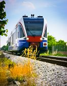 Low angle view of a commuter train in the countryside, Udine, Friuli, Italy Udine, Friuli, Italy poster