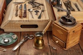 A Photo Of Many Vintage Objects, Flea Market Stuff On A Wooden Table