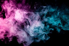Textural Background For Creativity . Dense Multicolored Smoke Of   Blue And Pink Colors On A Black I