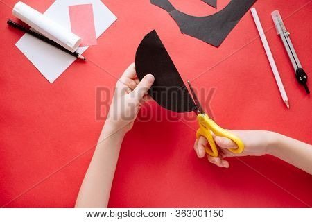 How To Make Bat Out Of Paper At Home. Hands Making Craft Out Of Paper. Step By Step Photo Instructio