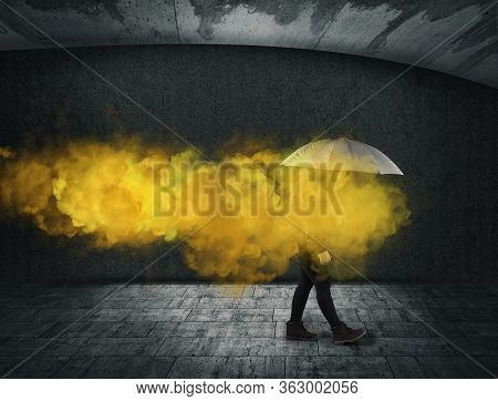 Woman Holding An Umbrella Yellow Smoke . Useless And Fail Concept . Anxiety And Mental Illness.