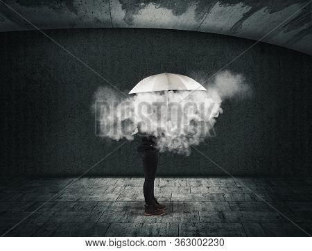 Woman Holding An Umbrella With A Cloud Inside . Useless And Fail Concept . Anxiety And Mental Illnes