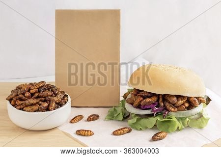 Food Insects: Silkworm Pupae Insect Deep-fried For Eating As Food In Bread Burger With Vegetable And