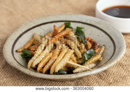 Food Insects: Bamboo Worm Or Bamboo Caterpillar Insect Deep-fried Crispy For Eating As Food Items In