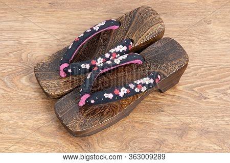 Japanese Traditional Geta Sandal On Wooden Floor. Traditional Japanese Asian Wood Footwear Called Ge
