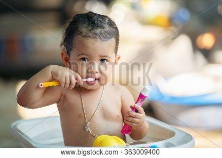 Dental Hygiene. Asian Cute Girl Or Kid Brushing Her Teeth By Toothbrush Outdoor Bathroom. Healthcare