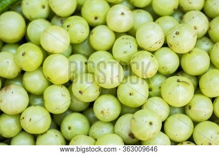 Fresh Amla Fruit On Local Market. Gooseberry For Sale In Bazaar Market. Indian Gooseberry (phyllanth