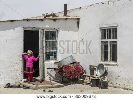 Alichur, Tajikistan - June 24, 2019: Child At The Door In Small Town Of Alichur In Region Murghob In