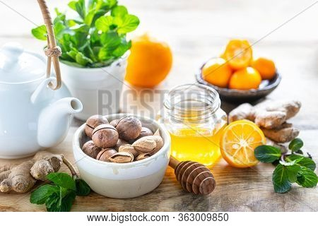 Set Of Products To Boost The Immune System. Honey, Lemon, Nuts, Ginger To Immunity Boosting