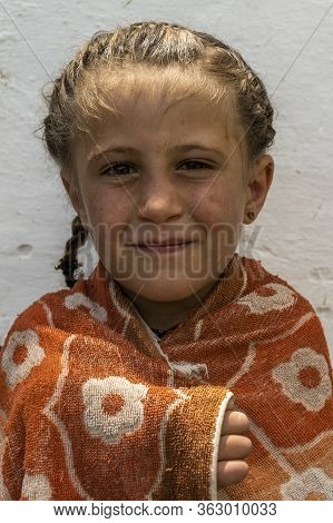 Wakhan, Tajikistan - June 20, 2020: Portrait Of A Girl In The Wakhan Valley At The Pamir Highway In